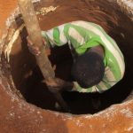 Digging a latrine pit